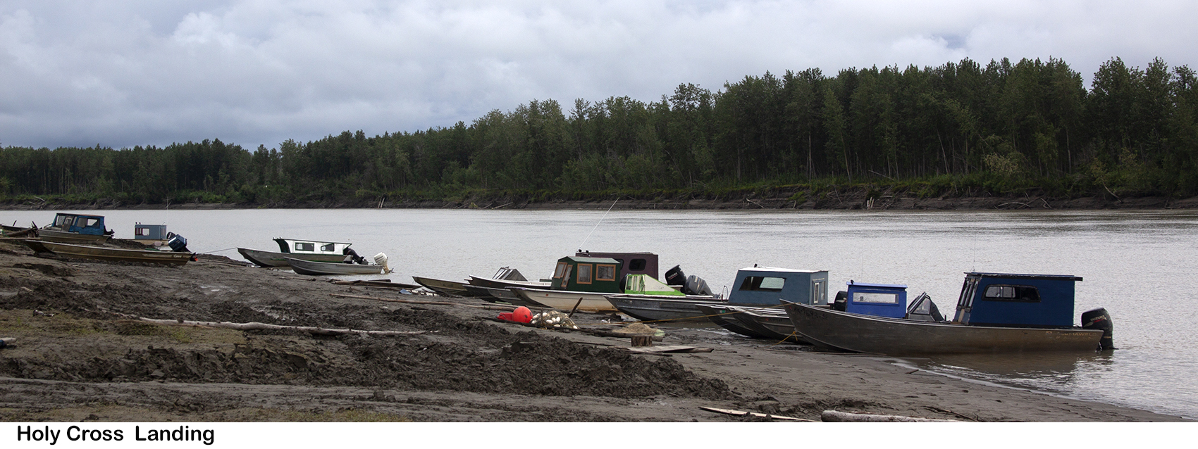 River boats on the banks of a slough off the Yukon River.
